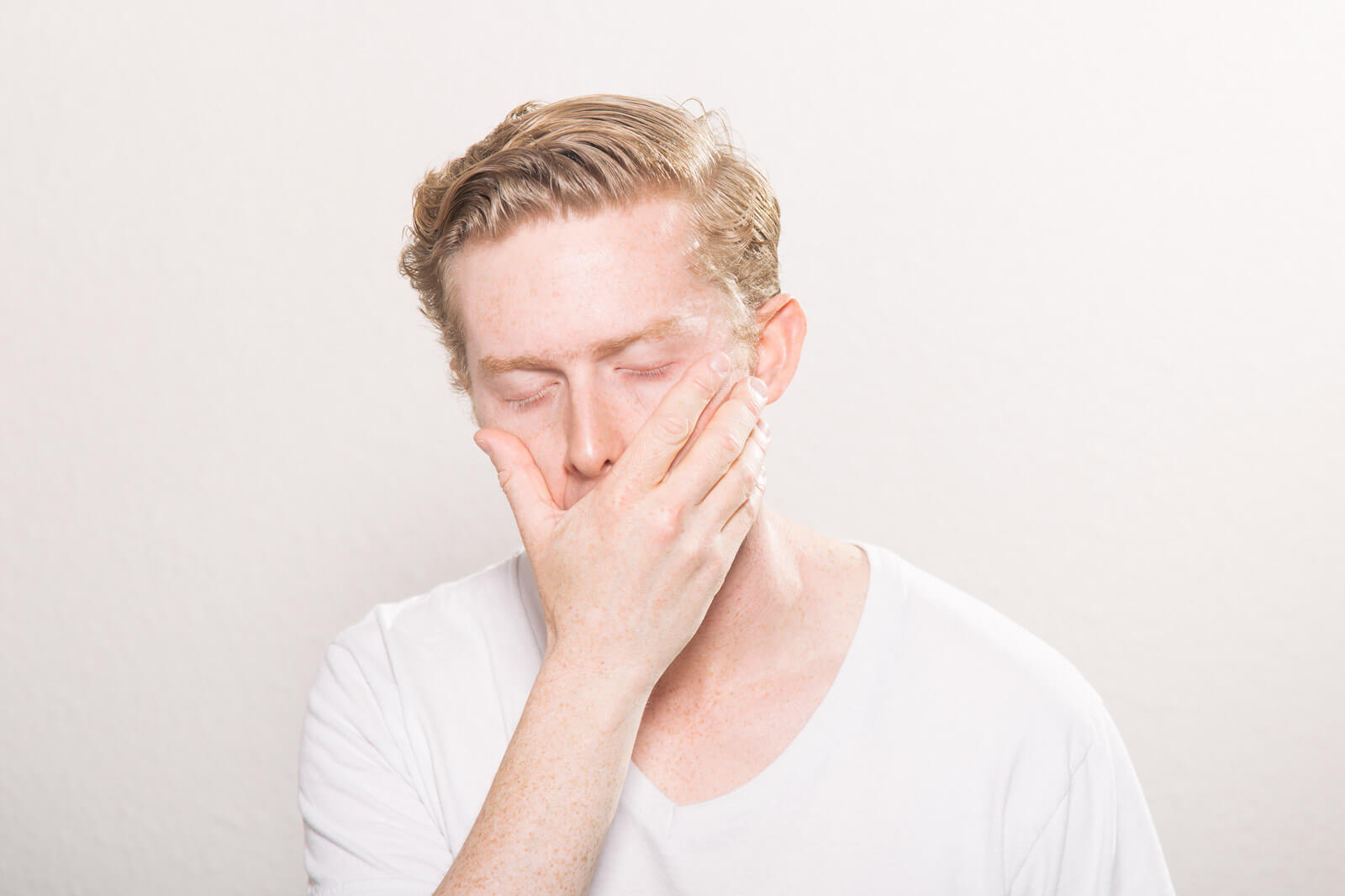 A man yawning because of extreme fatigue. Healthy sleep patterns can prevent you feeling tired and reduce anxiety.
